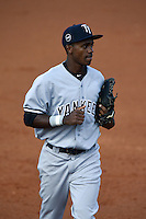 Tampa Yankees outfielder Claudio Custodio (30) jogs to the dugout in between innings during a game against the Lakeland Flying Tigers on April 9, 2015 at Joker Marchant Stadium in Lakeland, Florida.  Tampa defeated Lakeland 2-0.  (Mike Janes/Four Seam Images)