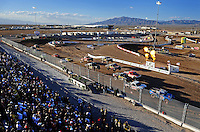 Nov. 6, 2010; Las Vegas, NV USA; LOORRS pro two unlimited driver Robby Woods (99) leads the field at the green flag during round 13 at the Las Vegas Motor Speedway short course. Mandatory Credit: Mark J. Rebilas-