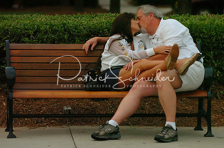 A couple kiss while listening to music played during annual Fourth of July Celebration and community parade in Birkdale Village in Huntersville, NC. Birkdale Village combines the best of shopping, dining, apartments and entertainment venues within a 52-acre mixed-use development.
