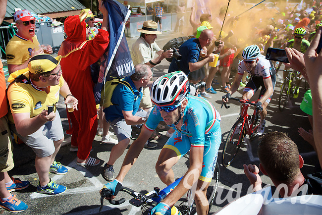 Vincenzo Nibali (ITA/Astana) experiencing the craziness at the Dutch Corner (nr7) up Alpe d'Huez as he is tailed by Bauke Mollema (NLD/Trek Factory Racing) who's name the (mostly drunken) fans have been chanting all afternoon<br /> <br /> stage 20: Modane Valfréjus - Alpe d'Huez (111km)<br /> 2015 Tour de France