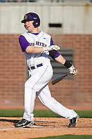Dustin Harrington #7 of the East Carolina Pirates follows through on his swing versus the Virginia Cavaliers at Clark-LeClair Stadium on February 19, 2010 in Greenville, North Carolina.   Photo by Brian Westerholt / Four Seam Images