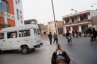 A young boy plays on a support wire in the Old Town section of Kashgar, Xinjiang, China.