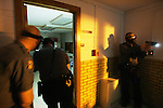 CHAD PILSTER · Hays Daily News<br /> <br /> (left to right) Trooper Adam Medlicott, and Lt. Joe Greene enter a room to search for a subject while Trooper Tod Hileman covers outside on Thursday, April 4, 2013 during a training by troopers with the Kansas State Highway Patrol at Trego Grade School in WaKeeney, Kansas. Troopers were practicing searching a building for a suspect that entered. They recently added high powered weapon mounted flashlights to their arsenal, so this was a chance to train with them.
