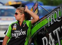 Apr. 27, 2012; Baytown, TX, USA: NHRA crew member for funny car driver Alexis DeJoria during qualifying for the Spring Nationals at Royal Purple Raceway. Mandatory Credit: Mark J. Rebilas-