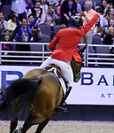 OMAHA, NEBRASKA - MAR 30: McLain Ward celebrates after winning the FEI World Cup Jumping Final II aboard HH Azur at the CenturyLink Center on March 31, 2017 in Omaha, Nebraska. (Photo by Taylor Pence/Eclipse Sportswire/Getty Images)