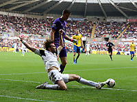 Saturday 28 September 2013<br /> Pictured L-R: Michu of Swansea attempts to keep the ball in play against Arsenal goalkeeper Wojciech Szczesny<br /> Re: Barclay's Premier League, Swansea City FC v Arsenal at the Liberty Stadium, south Wales.