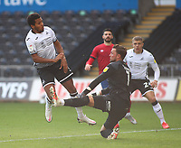 17th October 2020; Liberty Stadium, Swansea, Glamorgan, Wales; English Football League Championship Football, Swansea City versus Huddersfield Town; Korey Smith of Swansea City is challenged by Ben Hamer of Huddersfield Town resulting in a penalty to Swansea City in the first half