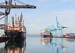 Ships loading containers at the Port of Tacoma terminals.  Tacoma,Washington, USA