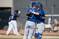 Los Angeles Dodgers relief pitcher Stephen Kolek (67) hugs Tre Todd (44) after an Instructional League game against the Milwaukee Brewers at Maryvale Baseball Park on September 24, 2018 in Phoenix, Arizona. (Zachary Lucy/Four Seam Images)