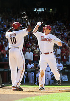 Apr. 5, 2010; Phoenix, AZ, USA; Arizona Diamondbacks shortstop Stephen Drew (right) is congratulated by teammate Justin Upton after hitting an two run inside the park home run against the San Diego Padres during opening day at Chase Field. Mandatory Credit: Mark J. Rebilas-
