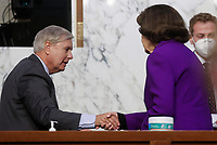 United States Senator Lindsey Graham (Republican of South  Carolina), Chairman, US Senate Judiciary Committee and United States Senator Dianne Feinstein (Democrat of California), Ranking Member, US Senate Judiciary Committee, shake hands at the conclusion of the fourth day of the confirmation hearing for Judge Amy Coney Barrett, President Donald Trump's Nominee for Supreme Court, in Hart Senate Office Building in Washington DC, on October 15th, 2020.<br /> Credit: Jonathan Ernst / Pool via CNP /MediaPunch