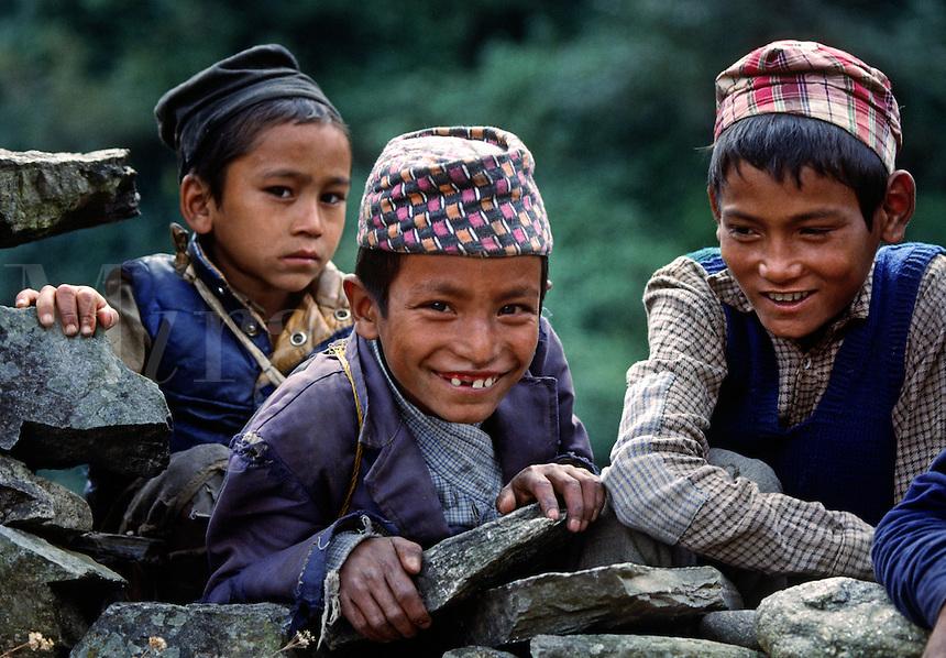 Chetri boys on a village wall - SOLU TREK, NEPAL