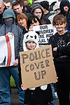 """© Joel Goodman - 07973 332324 . 03/03/2012 . Heywood , UK . A young girl holds up a sign that reads """" Police cover up """" . The National Front hold a rally in protest against an alleged paedophile ring that had been operating in the area . There is currently (3rd March 2012) a case being tried at Liverpool Crown Court in relation to the allegations . Last Thursday (23rd February 2012) a protest organised in the town in relation to the same story resulted in Asian business being attacked by an angry mob . Photo credit : Joel Goodman"""