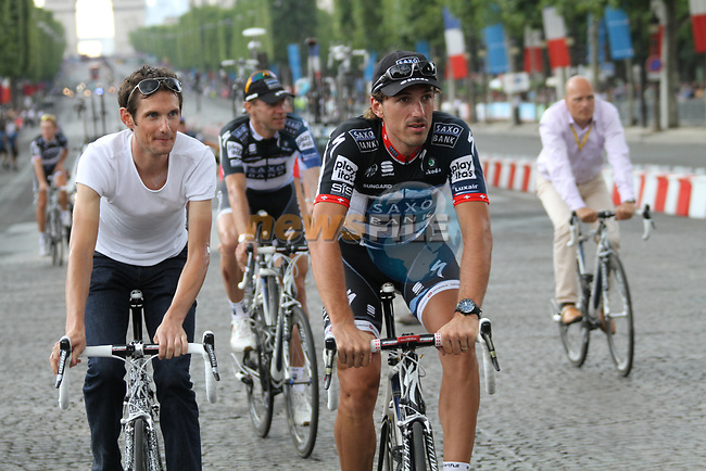 Frank Schleck (LUX), Jens Voigt (GER), Fabian Cancellara (SUI) and Saxo Bank part of the team parade at the end of the final Stage 20 of the 2010 Tour de France running 102.5km from Longjumeau to Paris Champs-Elysees, France. 25th July 2010.<br /> (Photo by Eoin Clarke/NEWSFILE).<br /> All photos usage must carry mandatory copyright credit (© NEWSFILE | Eoin Clarke)