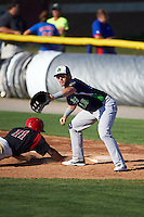 Vermont Lake Monsters first baseman Chris Iriart (18) stretches for a throw as Stone Garrett (11) dives back during a game against the Batavia Muckdogs August 9, 2015 at Dwyer Stadium in Batavia, New York.  Vermont defeated Batavia 11-5.  (Mike Janes/Four Seam Images)