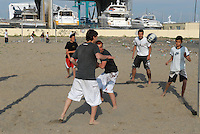 - Lido di Ostia, young people play in the degraded area  of Foce Tevere-Idroscalo street; shipyards....- Lido di Ostia, giovani giocano nell'area degradata di foce Tevere-via dell'Idroscalo; cantieri navali