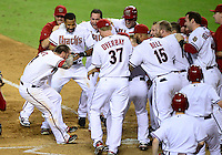 Jun. 8, 2012; Phoenix, AZ, USA; Arizona Diamondbacks third baseman Ryan Roberts (left) is congratulated by teammates after hitting a three run walk off home run in the ninth inning against the Oakland Athletics at Chase Field.  Mandatory Credit: Mark J. Rebilas-