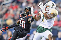 Baylor inside receiver Corey Coleman (1) catches a pass for a touchdown defended by Texas Tech defensive back Tevin Madison (20) during NCAA Football game, Saturday, November 29, 2014 in Arlington, Tex. (Mo Khursheed/TFV Media via AP Images)