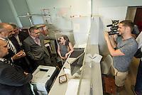 Zentrale Auslaenderbehoerde und BAMF-Aussenstelle in Eisenhuettenstadt.<br /> Bundesinnenminister Thomas de Maiziere und brandeburgs Ministerpraesident Dietmar Woidke besuchten am Donnerstag den 13. August 2015 die Zentrale Auslaenderbehoerde und BAMF-Aussenstelle in Eisenhuettenstadt. Sie liessen sich von Mitarbeitern die Situation in der Einrichtung zeigen und erklaeren, sprachen mit Fluechtlingen und besichtigten das auf dem Gelaende befindliche Abschiebegefaengnis.<br /> Der Besuch des Bundesinnenministers und des Ministerpraesidenten wurde von etwa 40 Journalisten begleitet.<br /> Im Bild: Bundesinnenminister de Maiziere besichtigt einen Abfertigungsraum fuer Asylantraege.<br /> 13.8.2015, Eisenhuettenstadt/Brandenburg<br /> Copyright: Christian-Ditsch.de<br /> [Inhaltsveraendernde Manipulation des Fotos nur nach ausdruecklicher Genehmigung des Fotografen. Vereinbarungen ueber Abtretung von Persoenlichkeitsrechten/Model Release der abgebildeten Person/Personen liegen nicht vor. NO MODEL RELEASE! Nur fuer Redaktionelle Zwecke. Don't publish without copyright Christian-Ditsch.de, Veroeffentlichung nur mit Fotografennennung, sowie gegen Honorar, MwSt. und Beleg. Konto: I N G - D i B a, IBAN DE58500105175400192269, BIC INGDDEFFXXX, Kontakt: post@christian-ditsch.de<br /> Bei der Bearbeitung der Dateiinformationen darf die Urheberkennzeichnung in den EXIF- und  IPTC-Daten nicht entfernt werden, diese sind in digitalen Medien nach §95c UrhG rechtlich geschuetzt. Der Urhebervermerk wird gemaess §13 UrhG verlangt.]