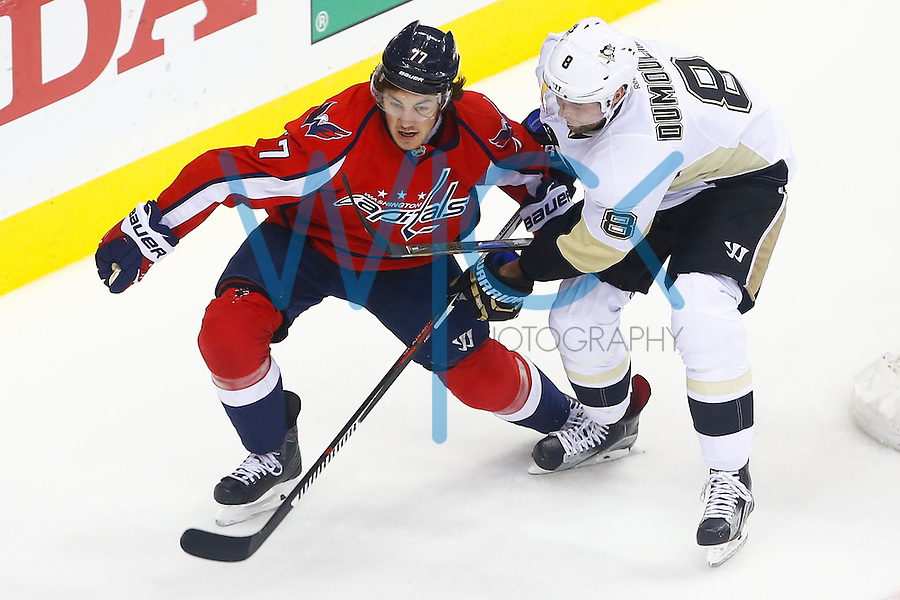 Brian Dumoulin #8 of the Pittsburgh Penguins and T.J. Oshie #77 of the Washington Capitals race to the puck in the corner in the first period during game two of the second round of the Stanley Cup Playoffs at Verizon Center in Washington D.C. on April 30, 2016. (Photo by Jared Wickerham / DKPS)