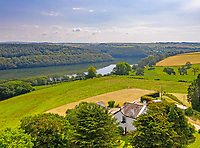BNPS.co.uk (01202 558833)<br /> Pic: LillicrapChilcott/BNPS<br /> <br /> Pictured: An aerial view of the property.<br /> <br /> A sprawling waterfront estate that has been in the same family for half a century is on the market for £2.25m.<br /> <br /> Bellscat Farmhouse is a pretty Grade II listed home with beautiful far-reaching views over Fowey River in Cornwall.<br /> <br /> The grand four-bedroom home looks a far cry from a typical farmhouse and is believed to have been two farm cottages that were converted into one home.<br /> <br /> There is also a separate two-bedroom barn and the properties sit in 37 acres of undulating land, creating a private and scenic estate.