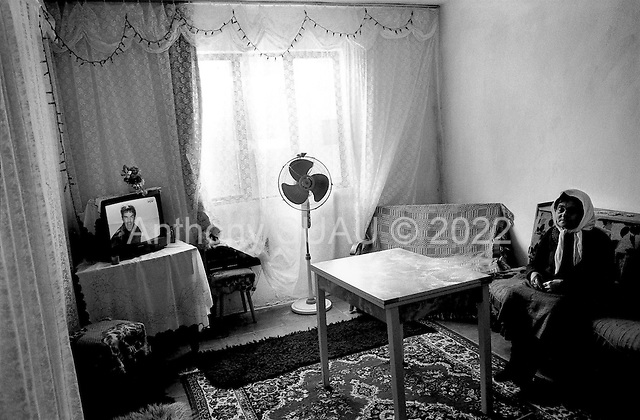 Sector Adriatic, Albania<br /> February 1997<br /> <br /> An old woman decorates her home with the little she has. She lives in a housing complex building originally as a political interment camp during the communist years. She has a color TV and satellite dish.