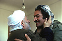 Iran 1979.The mullah of Oshnaviyeh welcoming Nabi Qadri, chief  peshmerga of KDPI Iran 1979 L'imam d'Oshnaviyeh accueillant Nabi Qadri , chef de peshmergas du Pdki