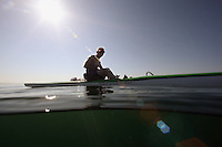 San Diego, CA, USA.  Thursday, July 15, 2010:  An outrigger canoist pases divers asscending from the Wreck of the Yukon where they held a press conference to mark the tenth anniversary of it's sinking.  The wreck was prepared and sunk to form an artificial reef for recreational divers to enjoy.