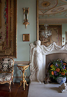 Detail of one of the draped figures that flank the firelace in the green drawing room. The plaque on the wall commemorates a Privy Council meeting held by Edward VII during Raceweek in 1908