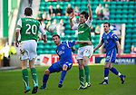 Hibs v St Johnstone.....30.04.11.Chris Millar holds off Callum Booth.Picture by Graeme Hart..Copyright Perthshire Picture Agency.Tel: 01738 623350  Mobile: 07990 594431