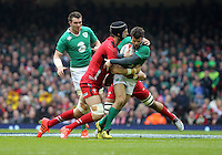 Pictured: Jared Payne of Ireland (R) tackled by Sam Warburton of Wales (L) Saturday 14 March 2015<br />