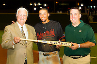 """Billy Hamilton (center) of the Bakersfield Blaze accepts his """"Top Star Award"""" from California League president Charlie Blaney (left) and Nathan Blackmon from MiLB.com at BB&T Ballpark on June 19, 2012 in Winston-Salem, North Carolina.  The Carolina League defeated the California League 9-1.  (Brian Westerholt/Four Seam Images)"""