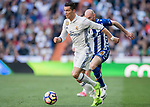 Cristiano Ronaldo (r) of Real Madrid runs past Gaizka Toquero Pinedo of Deportivo Alaves with the ball during their La Liga match between Real Madrid and Deportivo Alaves at the Santiago Bernabeu Stadium on 02 April 2017 in Madrid, Spain. Photo by Diego Gonzalez Souto / Power Sport Images