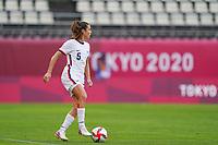 KASHIMA, JAPAN - JULY 27: Kelley O'Hara #5 of the United States controls the ball during a game between Australia and USWNT at Ibaraki Kashima Stadium on July 27, 2021 in Kashima, Japan.