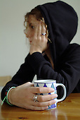 Teenage girl with a cup of tea (posed by model)