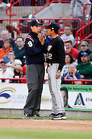 May 30, 2009:  Manager Mike Sarbaugh of the Akron Aeros argues a call with first base umpire Adam Hamari during a game at Jerry Uht Park in Erie, PA.  The Aeros are the Double-A Eastern League affiliate of the Cleveland Indians.  Photo By Mike Janes/Four Seam Images