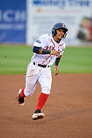 Salem Red Sox shortstop Santiago Espinal (5) runs the bases during the first game of a doubleheader against the Potomac Nationals on June 11, 2018 at Haley Toyota Field in Salem, Virginia.  Potomac defeated Salem 9-4.  (Mike Janes/Four Seam Images)