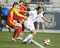 Abby Wambach #20 of the USA WNT shields the ball from Xinzhi Weng #5 of the PRC WNT during an international friendly match at PPL Park, on October 6 2010 in Chester, PA. The game ended in a 1-1 tie.