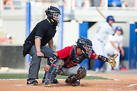 Elizabethton Twins catcher Rainis Silva (20) reaches for a pitch as home plate umpire Garon Keuten looks on during the game against the Kingsport Mets at Hunter Wright Stadium on July 9, 2015 in Kingsport, Tennessee.  The Twins defeated the Mets 9-7 in 11 innings. (Brian Westerholt/Four Seam Images)