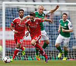 Graeme Shinnie and Shay Logan with Dylan McGeouch of Hibs