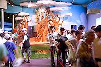 China. Shanghai. World Expo. Expo 2010 Shanghai China.  China Pavilion. Chinese tourists enter and exit the Inner Mongolia pavilion. Fake tree. 25.06.10 © 2010 Didier Ruef