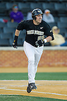 Matt Conway (25) of the Wake Forest Demon Deacons hustles down the first base line against the Missouri Tigers at Wake Forest Baseball Park on February 22, 2014 in Winston-Salem, North Carolina.  The Demon Deacons defeated the Tigers 1-0.  (Brian Westerholt/Four Seam Images)