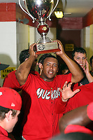 September 15 2008:  Miguel Tapia of the Batavia Muckdogs, Class-A affiliate of the St. Louis Cardinals, celebrate winning the NY-Penn League championship after a game at Dwyer Stadium in Batavia, NY.  Photo by:  Mike Janes/Four Seam Images