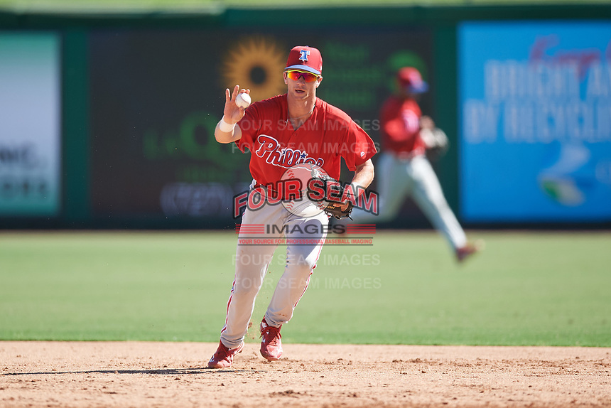 Philadelphia Phillies Madison Stokes (15) calls off the pitcher as he runs to tag first base after fielding a ground ball during a Florida Instructional League game against the New York Yankees on October 12, 2018 at Spectrum Field in Clearwater, Florida.  (Mike Janes/Four Seam Images)