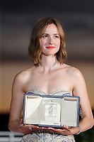 CANNES, FRANCE - JULY 17: Renate Reinsve poses with 'Best Actress Award' for 'The Worst Person in the World' during the 74th annual Cannes Film Festival on July 17, 2021 in Cannes, France. . <br /> CAP/GOL<br /> ©GOL/Capital Pictures