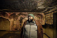 """Danny Barber, 41, stands in the burnt out lobby of the 18th floor of the """"Morrisania Air Rights"""" building at 3204 Park Ave. in the Morrisania section of the Bronx on Wednesday, March 2, 2011.  In December of 2010, a mattress was left in this lobby and set on fire, causing noticeable damage.  After three months, NYCHA has yet to restore the damaged lobby.  Barber, the tenant association's president at the nearby Andrew Jackson houses, has been lending a hand to the tenants at this public housing building with getting NYCHA to fix the damages."""