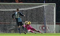 Goalkeeper Matt Ingram of Wycombe Wanderers pulls off a late save during the Sky Bet League 2 match between Wycombe Wanderers and Notts County at Adams Park, High Wycombe, England on 15 December 2015. Photo by Andy Rowland.