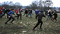12/02/13 ..The ball breaks from the hug in the annual Royal Shrovetide Football match in Ashbourne, Derbyshire. ..Shrovetide Football is played every Shrove Tuesday and Ash Wednesday. Unlike a conventional football match this game is played over two eight hour periods, the goals are three miles apart and there are very few rules...The leather ball which has a cork inner is 'turned up' from a stone plinth on Shaw Croft car park in Ashbourne town centre. The ball is thrown into the air and into the 'hug', a large group of players who try to move the ball to their goal by pushing against the opposition...Your team depends on which side of the Henmore brooke you were born on, those born on the South are Down'ards and try to goal the ball at the old Clifton Mill. Those born on the North are Up'ards and try to goal the ball at the old Sturston Mill...All Rights Reserved - F Stop Press.  www.fstoppress.com. Tel: +44 (0)1335 300098.