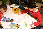 Elementary School Grade 3 geography boys working on map project