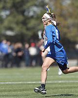 Duke University attacker Brigid Smith (6) brings the ball forward. Boston College (white) defeated Duke University (blue), 10-9, on the Newton Campus Lacrosse Field at Boston College, on April 6, 2013.